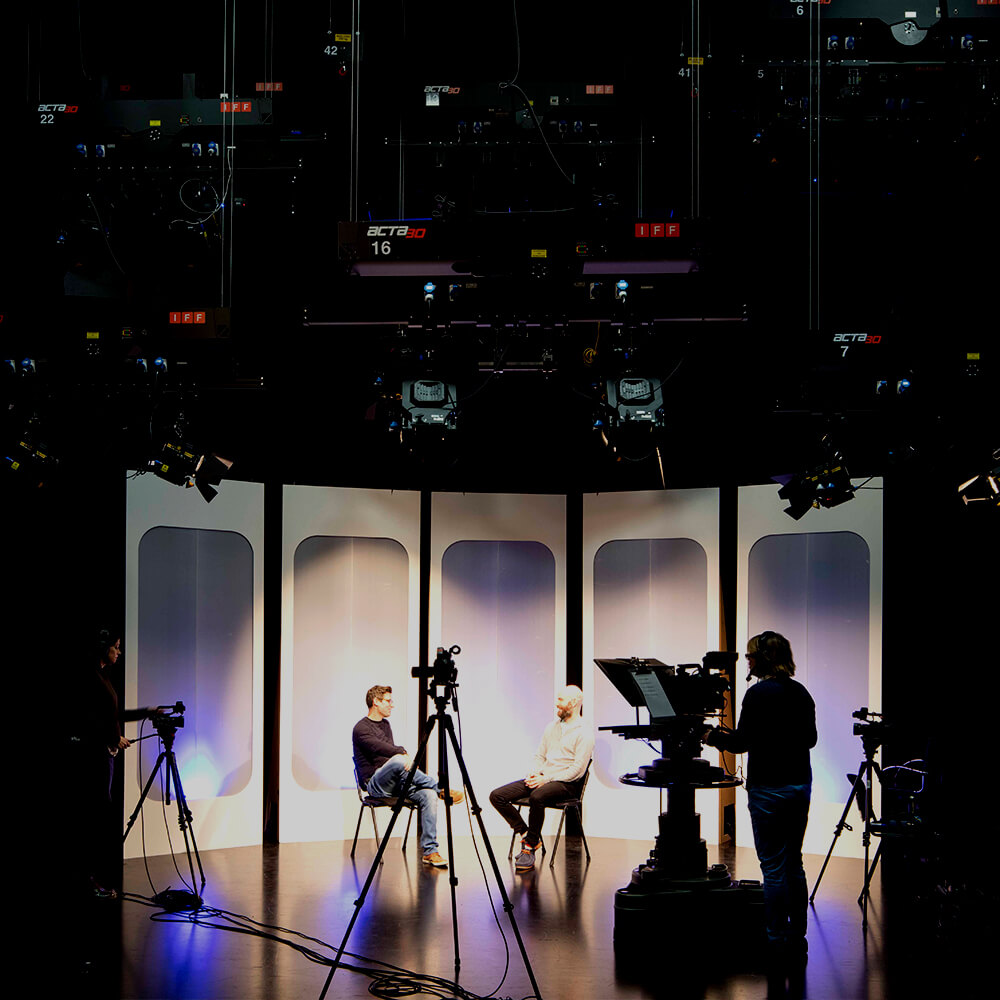 Students filming in the TV studio