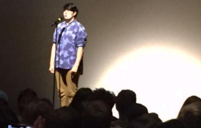 Student Alex Calver performs poetry in front of an audience