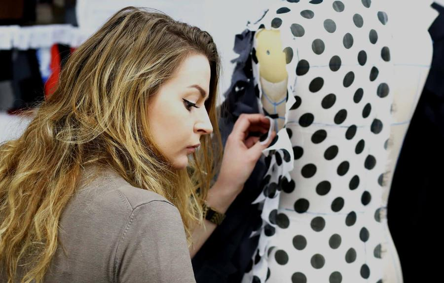 Student pins fabric to mannequin2