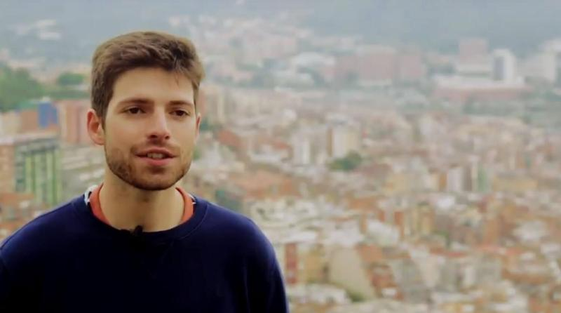 Young man with Barcelona citiscape behind him2