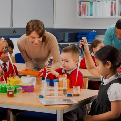 Primary school children using pipettes and beakers during a science lesson2