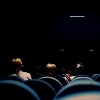 Cinema room in darkness with some people in the audience2