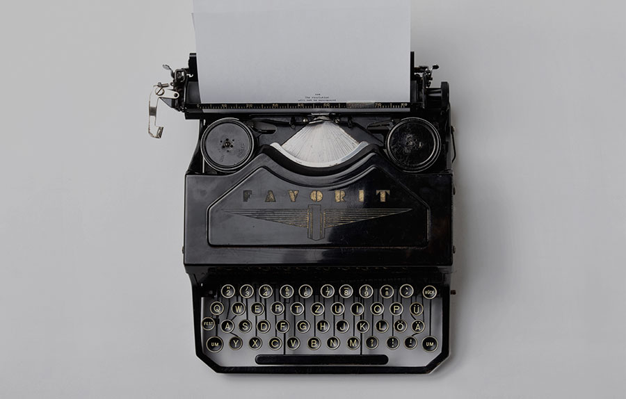A black old typewriter on a white background2