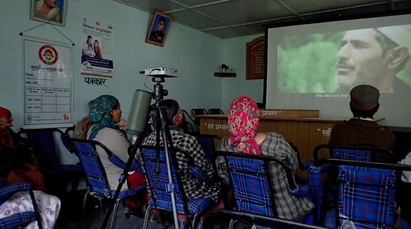 Screening of a film to a small audience in India2